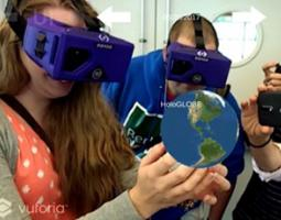 A woman wearing a VR headset holds the earth in her hands.