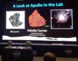 """Large projector screen displaying a slide entitled """"A Look at Apollo in the Lab""""."""