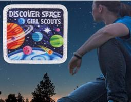 Discover Space Girl Scouts patch featuring colorful cartoon planets.