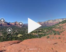 Video screenshot of the Sedona landforms with a large Play button.