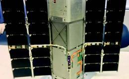 Photo of model of RAVAN with deployed solar panels