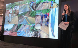 Photo of woman giving presentation about landslide susceptibility at AGU