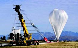 Photograph of balloon being inflated on airport tarmac
