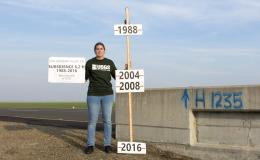 Photograph taken by Justin Brandt, USGS, of the National Geodetic Survey vertical control bench mark H1235 RESET in Merced Country, California.