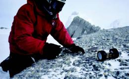 Photo of scientist testing PUFFER on snowy surface